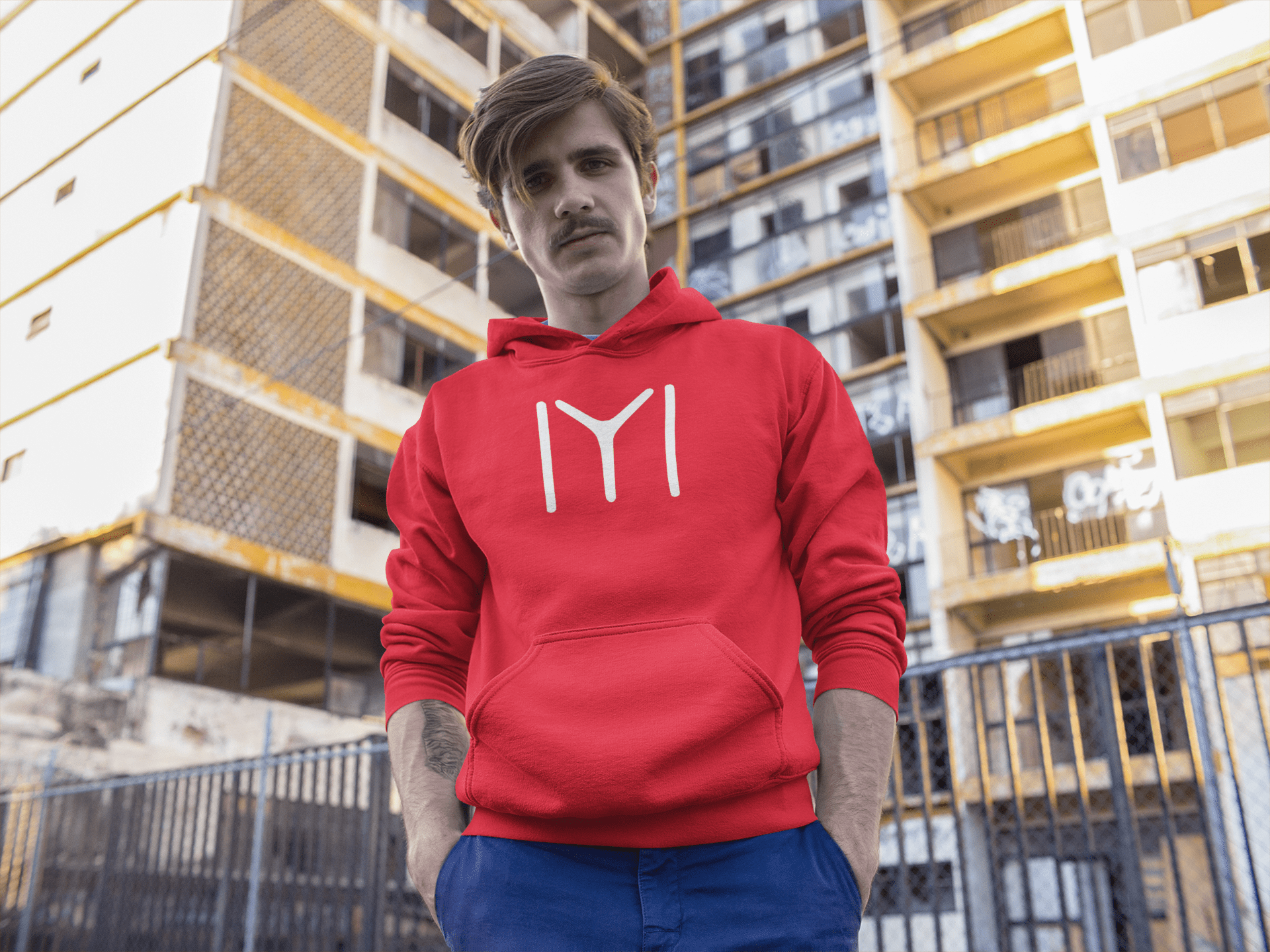 young-fella-wearing-a-pullover-hoodie-while-hanging-out-at-the-city-mockup-a13609