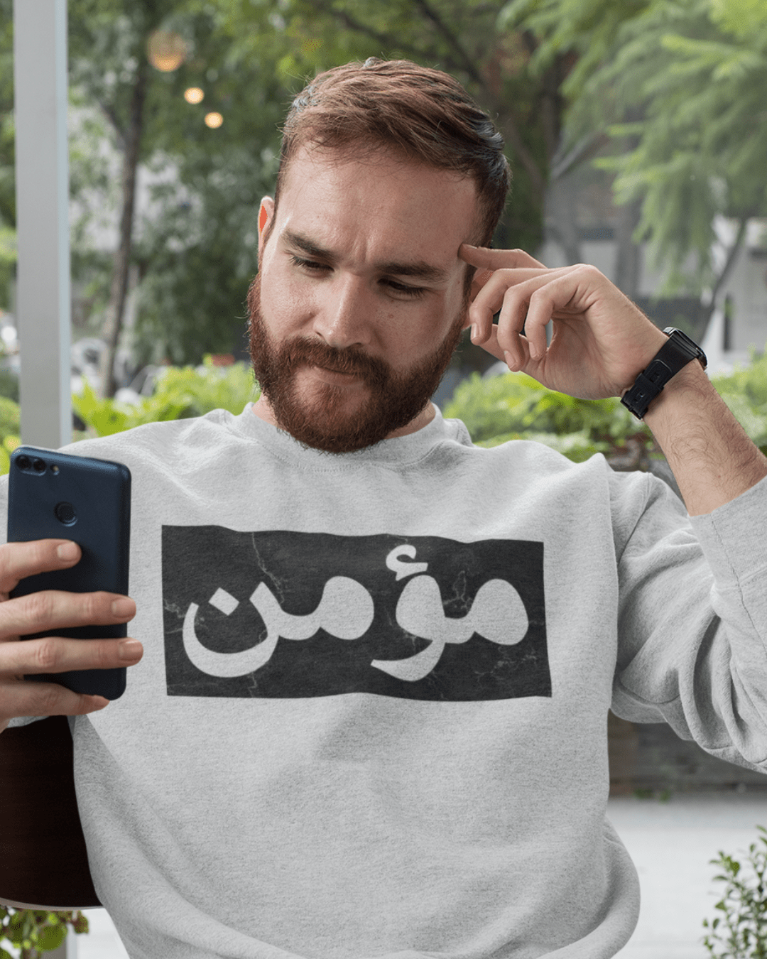 crewneck-sweatshirt-mockup-of-a-man-checking-his-phone-28735